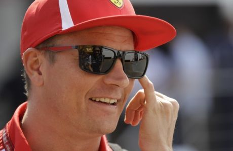 Ferrari driver Kimi Raikkonen of Finland smiles at the Monza racetrack, in Monza, Italy , Thursday, Aug.30, 2018. The Formula one race will be held on Sunday. (AP Photo/Luca Bruno)