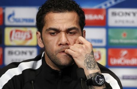 PSG's defender Dani Alves attends a press conference on the eve of the Champions League Round of 16 second leg soccer match between Paris Saint Germain and Real Madrid at the Parc des Princes stadium, in Paris, Monday, March. 5, 2018. (AP Photo/Francois Mori)