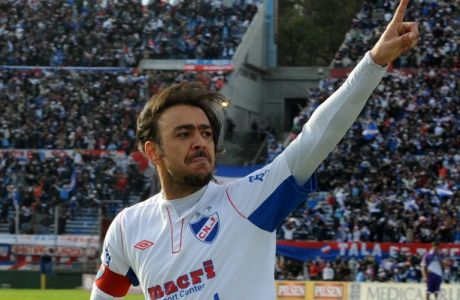 Uruguayan Nacional's Alvaro Recoba celebrates after scoring a goal against Defensor in their Uruguayan Championship football final match on June 16, 2012 in Montevideo. Nacional won by 1-0. AFP PHOTO/Miguel ROJO        (Photo credit should read MIGUEL ROJO/AFP/GettyImages)