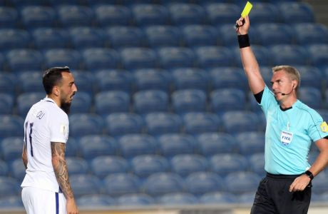 Referee Jakob Kehlet shows a yellow card to Greece's Kostas Mitroglou during the World Cup Group H qualifying soccer match between Gibraltar and Greece outside Faro, southern Portugal, Tuesday, Sept. 6, 2016. (AP Photo/Armando Franca)