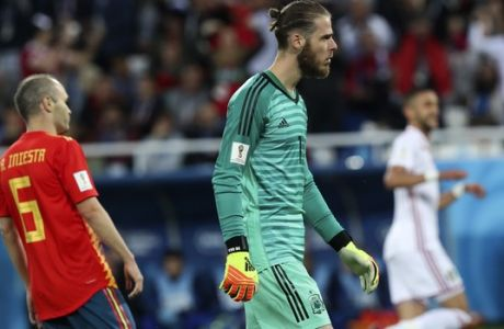Spain goalkeeper David De Gea, center, and Spain's Andres Iniesta, left, react after Morocco's Khalid Boutaib, background right, scores the opening goal during the group B match between Spain and Morocco at the 2018 soccer World Cup at the Kaliningrad Stadium in Kaliningrad, Russia, Monday, June 25, 2018. (AP Photo/Czarek Sokolowski)