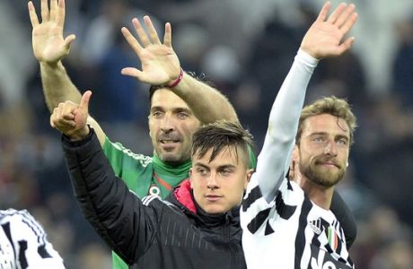 Juventus' Gianluigi Buffon, left, Paulo Dybala, center, and Claudio Marchisio celebrate at the end of a Serie A soccer match between Juventus and Sassuolo at the Juventus stadium, in Turin, Italy, Friday, March 11, 2016. (AP Photo/Massimo Pinca)