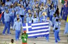 Athletes from Greece carry their flag into the closing ceremony in the Maracana stadium at the 2016 Summer Olympics in Rio de Janeiro, Brazil, Sunday, Aug. 21, 2016. (AP Photo/Charlie Riedel)