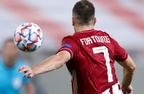 Ο Κώστας Φορτούνης σε στιγμιότυπο από την αναμέτρηση του Ολυμπιακού με την Ομόνοια για τα playoffs του Champions League 2020-2021. (LATO KLODIAN / EUROKINISSI)