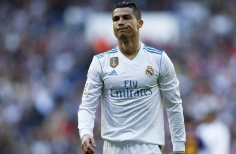 Real Madrid's Cristiano Ronaldo reacts during the Spanish La Liga soccer match between Real Madrid and Barcelona at the Santiago Bernabeu stadium in Madrid, Spain, Saturday, Dec. 23, 2017. (AP Photo/Francisco Seco)