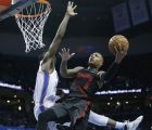 Portland Trail Blazers guard Damian Lillard (0) shoots in front of Oklahoma City Thunder forward Jerami Grant, left, in the second half of an NBA basketball game in Oklahoma City, Tuesday, Jan. 22, 2019. (AP Photo/Sue Ogrocki)