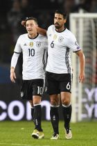 Germanys Sami Khedira, right, celebrates with Germanys Mesut Ozil after scoring his sides second goal during the World Cup Group C qualifying soccer match between Germany and Northern Ireland in Hannover, Germany, Tuesday, Oct. 11, 2016. (AP Photo/Martin Meissner)