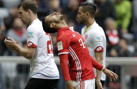 Bayern's Thiago reacts after missing a chance to score during the German Bundesliga soccer match between FC Bayern Munich and FSV Mainz 05 at the Allianz Arena stadium in Munich, Germany, Saturday, April 22, 2017. (AP Photo/Matthias Schrader)