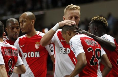 Monaco players with Kylian MBappe Lottin, center right, celebrate their opening goal during the League One soccer match Monaco against Saint Etienne, at the Louis II stadium in Monaco, Wednesday, May 17, 2017. (AP Photo/Claude Paris)