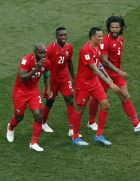 Panama' Felipe Baloy, left, celebrate with teammates after scoring his site's first goal during the group G match between England and Panama at the 2018 soccer World Cup at the Nizhny Novgorod Stadium in Nizhny Novgorod, Russia, Sunday, June 24, 2018. (AP Photo/Darko Bandic)