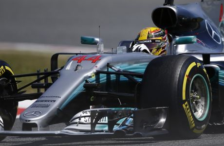 Mercedes driver Lewis Hamilton of Britain steers his car during the qualifying session for the Spanish Formula One Grand Prix at the Barcelona Catalunya racetrack in Montmelo, Spain, Saturday, May 13, 2017. The Spanish Formula One Grand Prix will take place on Sunday. (AP Photo/Manu Fernandez)