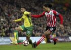 Norwich City's Josh Murphy, left, and Southampton's Virgil van Dijk battle for the ball during the English FA Cup, third round soccer match at Carrow Road, Norwich, England, Saturday Jan. 7, 2017. (Chris Radburn/PA via AP)