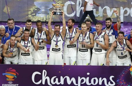 Slovenia's team celebrates with the trophy after defeating Serbia in their Eurobasket European Basketball Championship final match in Istanbul, Sunday, Sept. 17. 2017. (AP Photo/Emrah Gurel)