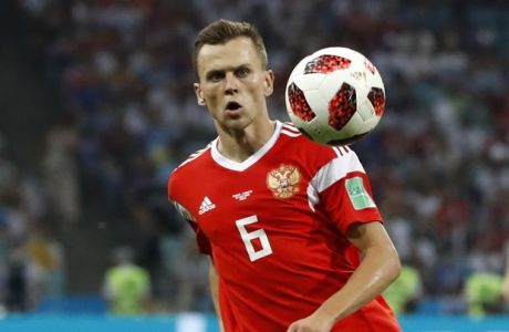 Russia's Denis Cheryshev controls the ball during the quarterfinal match between Russia and Croatia at the 2018 soccer World Cup in the Fisht Stadium, in Sochi, Russia, Saturday, July 7, 2018. (AP Photo/Rebecca Blackwell)