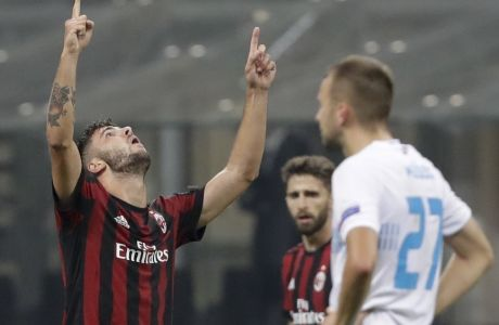 AC Milan's Patrick Cutrone celebrates after scoring his side's third goal during the Europa League group D soccer match between AC Milan and Rijeka, at the Milan San Siro Stadium, Italy, Thursday, Sept. 28, 2017. (AP Photo/Luca Bruno)