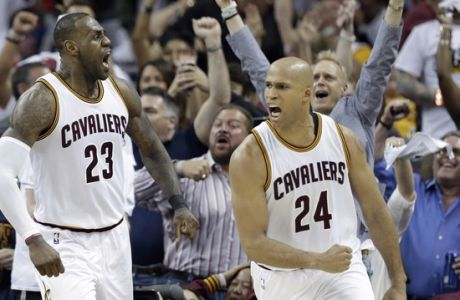 Cleveland Cavaliers' LeBron James (23) and Richard Jefferson (24) celebrate after James makes a basket in the second half in Game 1 of a first-round NBA basketball playoff series against the Indiana Pacers, Saturday, April 15, 2017, in Cleveland. The Cavaliers won 109-108. (AP Photo/Tony Dejak)