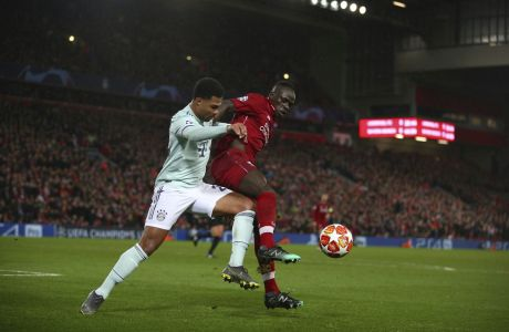 Liverpool's Sadio Mane, right, competes for the ball with Bayern forward Serge Gnabry during the Champions League round of 16 first leg soccer match between Liverpool and Bayern Munich at Anfield stadium in Liverpool, England, Tuesday, Feb. 19, 2019. (AP Photo/Dave Thompson)