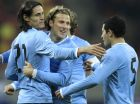 Uruguay's Edinson Cavani, left, celebrates opening the score against Romania with Diego Forlan, center, and Walter Gargano, right, during a friendly international soccer game in Bucharest, Romania, Wednesday, Feb. 29, 2012.(AP Photo/Vadim Ghirda)