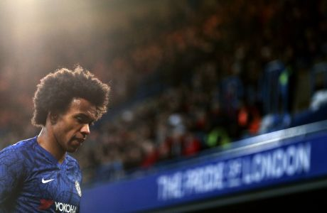 Chelsea's Willian walks during the English Premier League soccer match between Chelsea and Bournemouth, at Stamford Bridge in London, Saturday, Dec. 14, 2019. (AP Photo/Ian Walton)