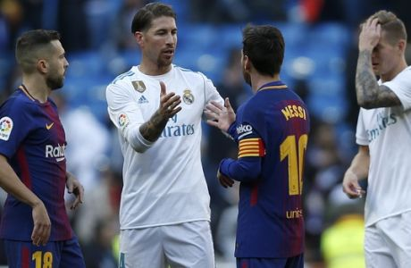 Real Madrid's Sergio Ramos, center left, shakes hands with Barcelona's Lionel Messi at the end of the Spanish La Liga soccer match between Real Madrid and Barcelona at the Santiago Bernabeu stadium in Madrid, Spain, Saturday, Dec. 23, 2017. Barcelona won 3-0. (AP Photo/Francisco Seco)