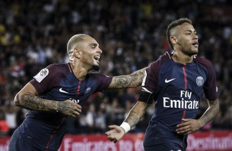 PSG's Neymar, right, and PSG's Layvin Kurzawa after scoring against Toulouse during the French League One soccer match between PSG and Toulouse at the Parc des Princes stadium in Paris, France, Sunday, Aug. 20, 2017. (AP Photo/Kamil Zihnioglu)