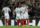 England's Eric Dier is celebrated by teammates after scoring during the World Cup Group F qualifying soccer match between England and Slovakia at Wembley Stadium in London, England, Monday, Sept. 4, 2017. (AP Photo/Kirsty Wigglesworth)