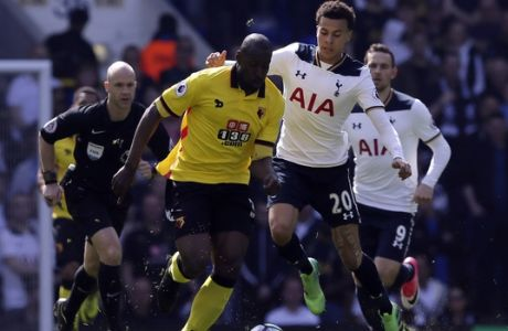 Watford's Stefano Okaka Chuka, left, competes for the ball with Tottenham's Dele Alli during the English Premier League soccer match between Tottenham Hotspur and Watford at White Hart Lane in London, Saturday April 8, 2017. (AP Photo/Tim Ireland)