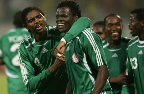 Nigeria's Ismaila Taye his huged by Nwankwo Kanu, left, as they celebrate a goal during the African Nations Cup Group D soccer match Between Ghana and Nigeria in Port Said Stadium, Egypt Monday Jan. 23, 2006. (AP Photo/Ariel Schalit)
