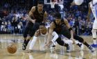 Oklahoma City Thunder guard Russell Westbrook, center, Portland Trail Blazers guard C.J. McCollum, left, and guard Evan Turner, right, chase a loose ball in the first half of an NBA basketball game in Oklahoma City, Tuesday, Jan. 22, 2019. (AP Photo/Sue Ogrocki)