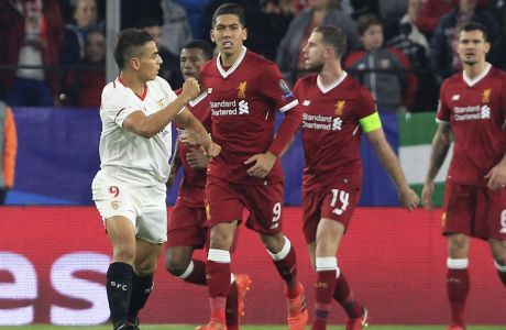 Sevilla's Wissam Ben Yedder, left, celebrates after scoring his side's first goal during a Champions League group E soccer match between Sevilla and Liverpool, at the Ramon Sanchez Pizjuan stadium in Seville, Spain, Tuesday, Nov. 21, 2017. (AP Photo/Miguel Morenatti)