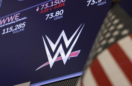 The logo for World Wrestling Entertainment, WWE, appears above a trading post on the floor of the New York Stock Exchange, Friday, Sept. 13, 2019. (AP Photo/Richard Drew)