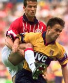 PSV Eindhoven's Ernest Faber clears the ball in front of Arsenal's Marc Overmars during the friendly match in Eindhoven Wednesday July 30 1997.(AP Photo/Dusan Vranic)
