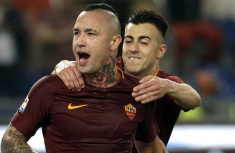Roma's Radja Nainggolan, left, celebrates with his teammate Stephan El Shaarawi after scoring his side's third goal during a Serie A soccer match between Roma and Juventus, at Rome's Olympic stadium, Sunday, May 14, 2017. (AP Photo/Gregorio Borgia)