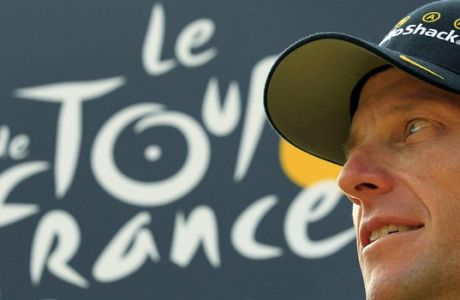 FILE - This file photo taken July 25, 2010, shows seven-time Tour de France champion Lance Armstrong looking back on the podium after the 20th and last stage of the Tour de France cycling race in Paris, France.  Lawyers for Armstrong go to federal court Friday, Aug. 10, 2012,  to ask U.S. District Judge Sam Sparks to block the U.S. Anti-Doping Agency from pursuing charges that he used performance-enhancing drugs during his career. (AP Photo/Bas Czerwinski, File)