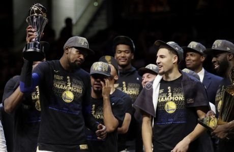 Golden State Warriors' Kevin Durant holds his NBA Finals MVP trophy after the Warriors defeated the Cleveland Cavalier 108-85 in Game 4 of basketball's NBA Finals to win the NBA championship, Friday, June 8, 2018, in Cleveland. (AP Photo/Tony Dejak)