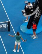 Greece's Stefanos Tsitsipas argues with the chair umpire during his fourth round match against Switzerland's Roger Federer at the Australian Open tennis championships in Melbourne, Australia, Sunday, Jan. 20, 2019. (AP Photo/Aaron Favila)