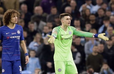 Chelsea goalkeeper Kepa Arrizabalaga, right, and Chelsea's David Luiz react during the English League Cup final soccer match between Chelsea and Manchester City at Wembley stadium in London, England, Sunday, Feb. 24, 2019. (AP Photo/Tim Ireland)