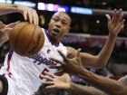 Los Angeles Clippers forward Caron Butler battles against the New Orleans Hornets for a loose ball during the second half of an NBA basketball game in Los Angeles, Monday, Nov. 26, 2012. The Hornets won 105-98. (AP Photo/Chris Carlson)