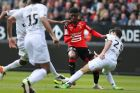 Rennes' Ousmane Dembele, second right, challenges for the ball with Guingamp's Christophe Kerbrat during their French League One soccer match, Sunday, April 17, 2016, in Rennes, western France. (AP Photo/David Vincent)