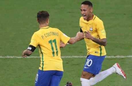 Brazils Philippe Coutinho, left, is congratulated by his teammate Neymar after scoring his side's first goal against Argentina during a 2018 World Cup qualifying soccer match at the Estadio Mineirao in Belo Horizonte, Brazil, Thursday Nov. 10, 2016. (AP Photo/Eugenio Savio)