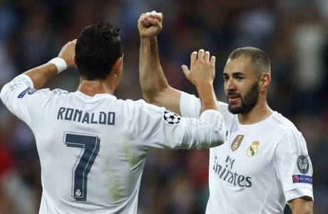 Real Madrid's Karim Benzema celebrates scoring the opening goal next to his teammate Cristiano Ronaldo during a Group A Champions League soccer match between Real Madrid and Shakhtar Donetsk at the Santiago Bernabeu stadium in Madrid, Spain, Tuesday, Sept. 15, 2015. (AP Photo/Francisco Seco)