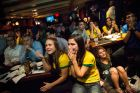 NEW YORK, NY - JUNE 12:  Brazilian soccer fans react in shock after Croatia scores first in the Brazil vs. Croatia World Cup game at Legends Bar on June 12, 2014 in New York City. Brazil vs Croatia is the first game of the World Cup, which will take place throughout Brazil until Sunday, July 13.  (Photo by Andrew Burton/Getty Images)