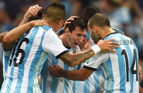 RIO DE JANEIRO, BRAZIL - JUNE 15:  Lionel Messi of Argentina celebrates with team-mates after scoring a goal during the 2014 FIFA World Cup Brazil Group F match between Argentina and Bosnia-Herzegovina at Maracana on June 15, 2014 in Rio de Janeiro, Brazil.  (Photo by Shaun Botterill - FIFA/FIFA via Getty Images)