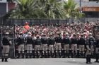 Security forces stand guard outside outside Antonio Vespucio Liberti stadium where River Plate soccer fans  gather before the announcement that their team's final Copa Libertadores match against rival Boca Juniors is suspended for a second day in a row in Buenos Aires, Argentina, Sunday, Nov. 25, 2018. In one of the most embarrassing weekends in South American football history, the Copa Libertadores final was once more postponed on Sunday. The same decision was made on Saturday after Boca's bus was attacked by River fans.  (AP Photo/Diego Martinez)