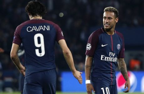 PSG's Neymar, right, looks teammate Edinson Cavani during the Champions League Group B soccer match between Paris Saint-Germain and Bayern Munich in Paris, France, Wednesday, Sept. 27, 2017. (AP Photo/Thibault Camus)