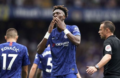Chelsea's Tammy Abraham celebrates scoring his side's second goal of the game during their English Premier League soccer match against Sheffield United at Stamford Bridge, London, Saturday, Aug. 31, 2019. (John Walton/PA via AP)