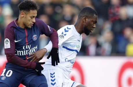 PSG's Neymar challenges for the ball with Strasbourg's Jean Aholou during the French League One soccer match between Paris Saint Germain and Strasbourg, at the Parc des Princes stadium in Paris, France, Saturday, Feb. 17, 2018. (AP Photo/Francois Mori)