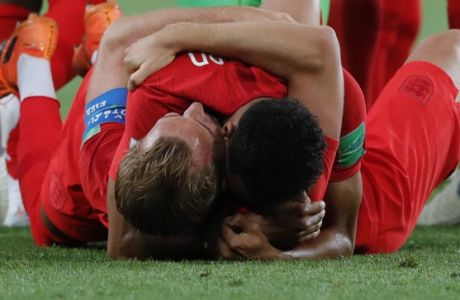 England's Harry Kane, bottom, and teammate Jesse Lingard embrace after beating Colombian in a penalty shoot out in a round of 16 match at the 2018 soccer World Cup in the Spartak Stadium, in Moscow, Russia, Tuesday, July 3, 2018. (AP Photo/Ricardo Mazalan)