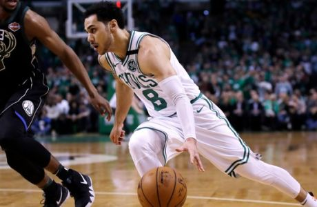 Boston Celtics guard Shane Larkin (8) drives to the basket against Milwaukee Bucks guard Sterling Brown (23) during Game 2 of an NBA basketball first-round playoff series in Boston, Tuesday, April 17, 2018. The Celtics defeated the Bucks 120-106. (AP Photo/Charles Krupa)
