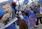 Supporters of Ukrainian opposition leader and presidential candidate Viktor Yanukovych react holding his portrait during a rally in front of the Central Election Commission, in Kiev, Ukraine, Tuesday, Feb. 9, 2010. Ukraine's Prime Minister Yulia Tymoshenko's campaign said Tuesday it plans to legally challenge the results of the presidential runoff that opposition leader Viktor Yanukovych appears to have won. Yanukovych's Party of Regions, meanwhile, rejected calls for further scrutiny of the election. (AP Photo/Sergei Grits)